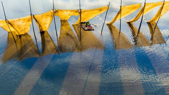 Fishermen close the net