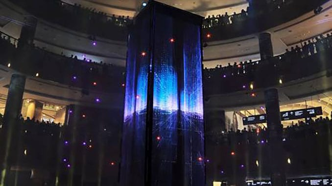 Dancing Drones Swarm Around A Pillar Of LED Screens At The Dubai Mall's 10 Year Celebrations